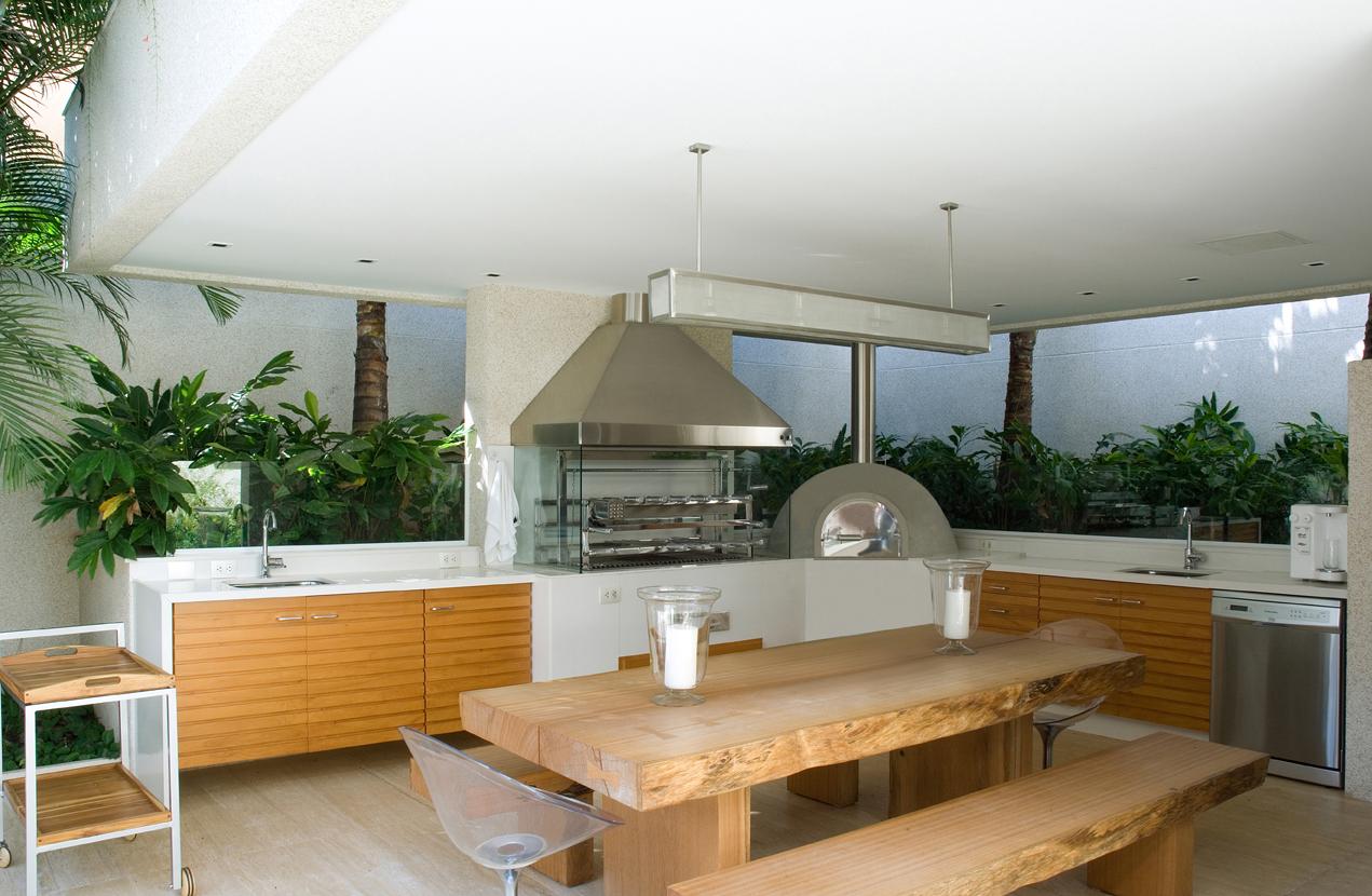 area de lazer com churrasqueira moderna #9E6B2D 1271 830