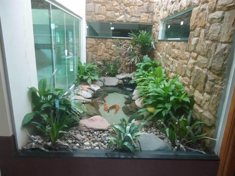 jardim de inverno na sala simples
